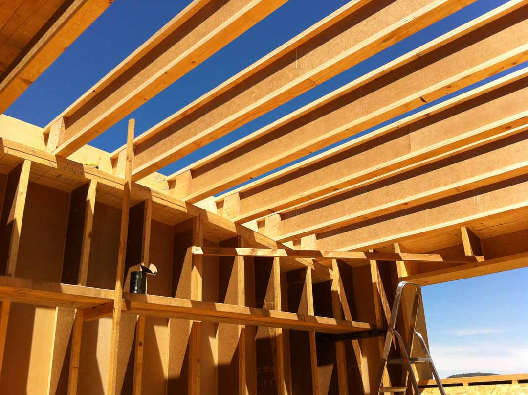 Les vans maison ossature bois toiture courbe de for Poutre i bois prix