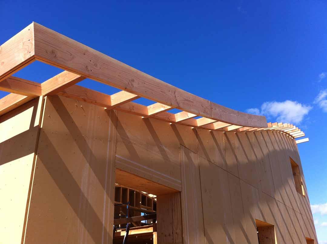 les vans maison ossature bois toiture courbe de pierres et de bois. Black Bedroom Furniture Sets. Home Design Ideas